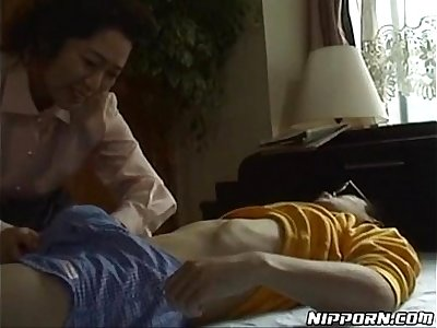 Mature Japanese chick pleasing her young boyfriend